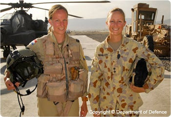 Women soldiers with helicopter. Image (c) Defence