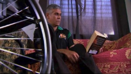 Paul Gooda reading a book at home