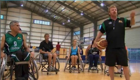 Paul Gooda on the court playing wheelchair basketball