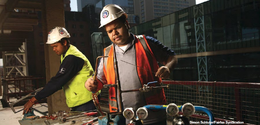 Aboriginal workers on industrial machinery