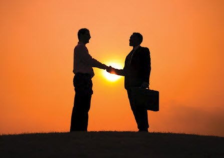 Shaking hands in the sunset