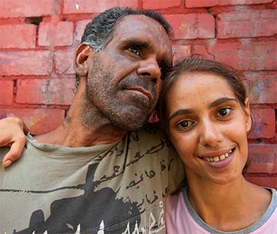 Indigenous girl with her father