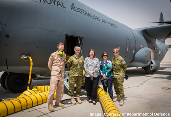 Sex Discrimination Commissioner Kate Jenkins in front of a RAAF jet
