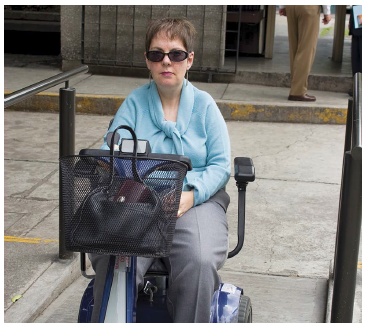 Person accessing ramp using mobility scooter