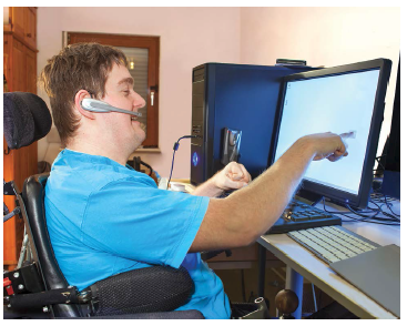 Happy computer user with disabilities using computers and audio devices