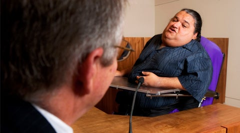 Disabled man in court room