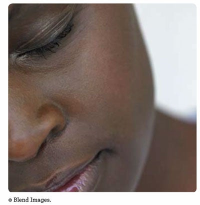African woman from the report cover. (c) Blend images