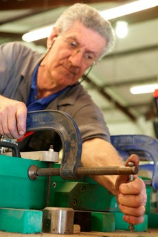 Mature age man working with machinery