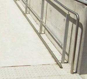 Kerb rail but intrudes into traffic area of ramp