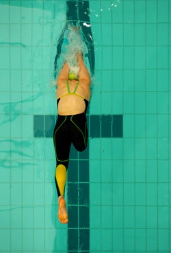 Disabled athlete swimming