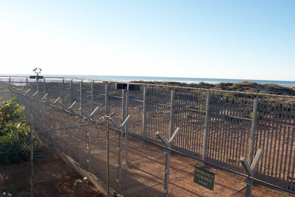 View through the perimeter fence at Port Hedland Immigration Reception and Processing Centre, June 2002.