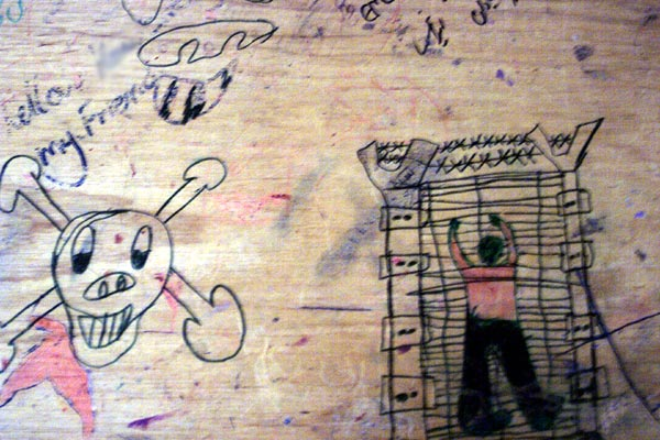 Drawings on a school desk at Port Hedland, June 2002.