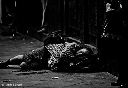 A homeless man sleeping on the street