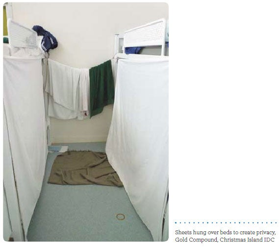 Sheets hung over beds to create privacy, Gold Compound, Christmas Island IDC