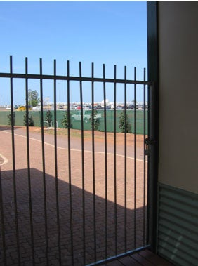 External fence and view to airport, Airport Lodge