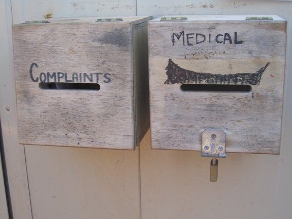 Unlocked complaints box next to locked medical request box, Curtin IDC