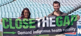 Picture of Cathy Freeman and Ian Thorpe holding a Close the Gap banner