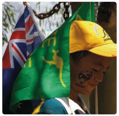 Happy boy of Asian-Australian background on Australia Day with flags and Go Aussie facepaint. (c) Laura MacDougall