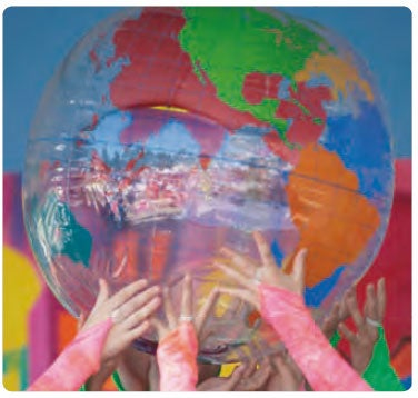 Young people's hands holding a globe of the world aloft (c) Arthur Roy
