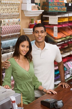 Couple behind shop register