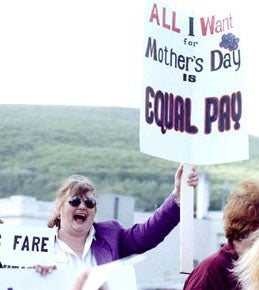 "Woman protester with sign that reads ""All I want for Mother's Day is Equal Pay!"" Photograph by Shannon de Celle"