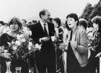 From left to right, Pamela Denoon, Ian Macphee, Sen. Susan Ryan, celebrating passage of Sex Discrimination Act 1984. Photo - WEL History project / Christine Fernon