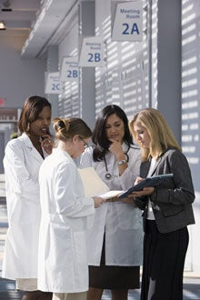 3 females doctors having a discussion with another female