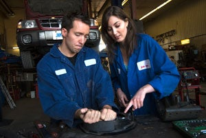 A male and female mechanic working together