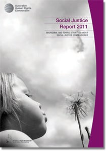 Social Justice Report 2010 cover - An Indigenous hand and a non-Indigenous hand holding each other