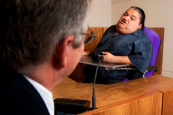 Man with disability in court room