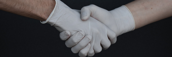 Handshake in white gloves