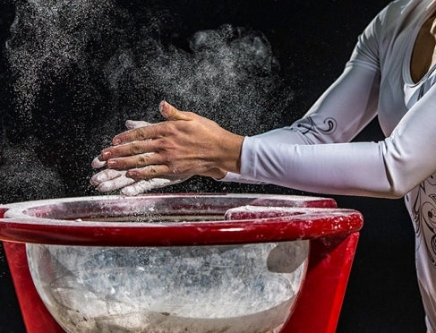 Gymnast applying chalk