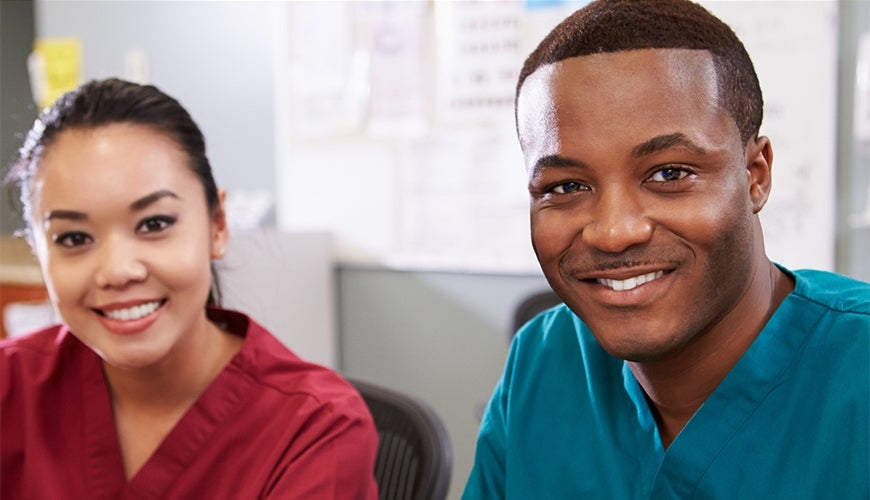 Female and male nurses smiling