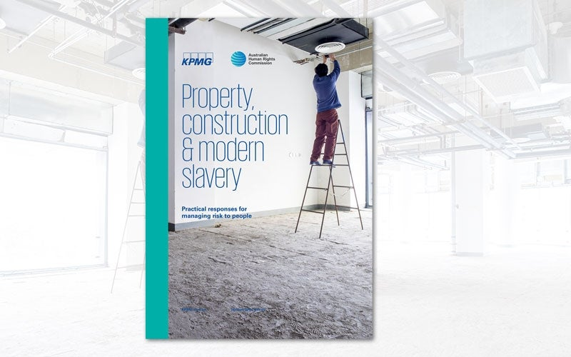 Man on ladder on building site. Modern Slavery construction industry cover.