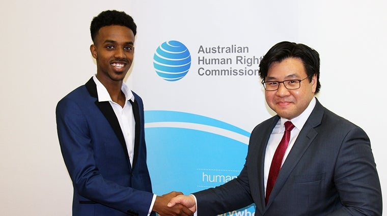 Mohamed Semra winning the 'Racism. It Stops With Me' essay prize, presented by Dr Tim Soutphommasane