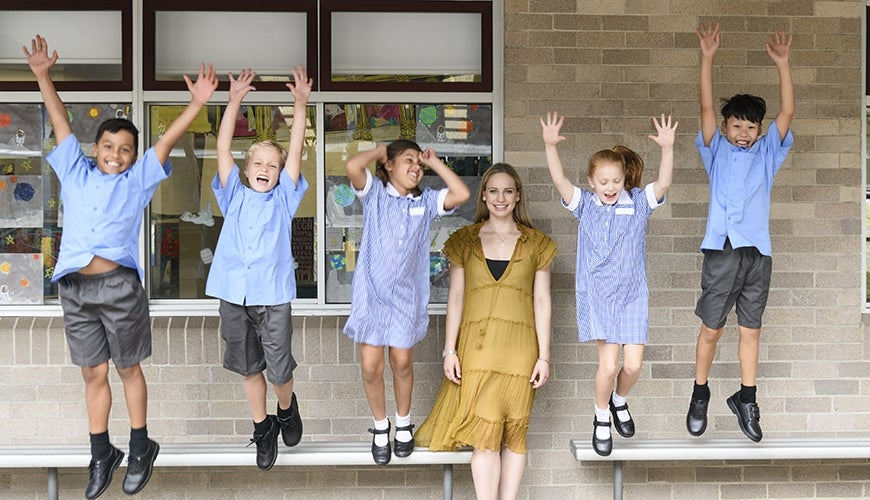 children at school jumping with joy