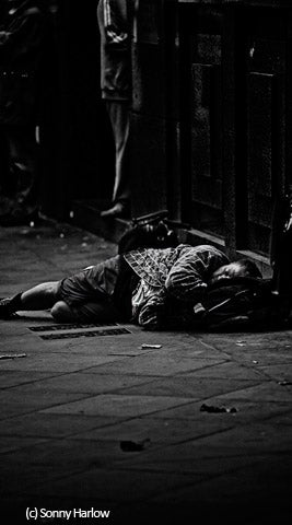 Homeless man sleeping (c) Sonny Harlow