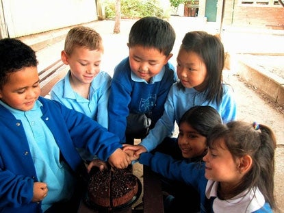 Photo: Cooperation by Amanda Lim - school children sharing a cake