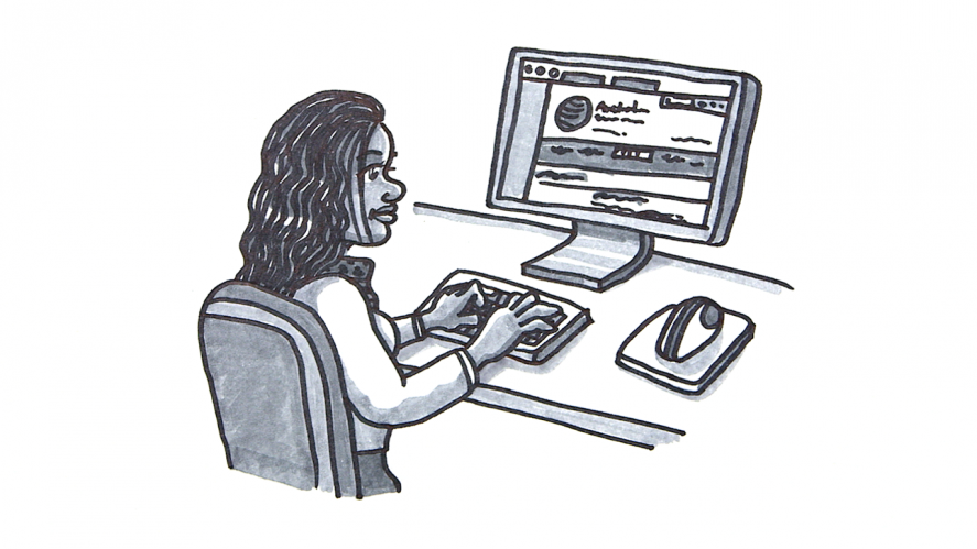 Woman sitting at computer looking at AHRC website