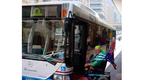 Paralympian and PWD NSW member Mr Alan Sargent boards an accessible bus