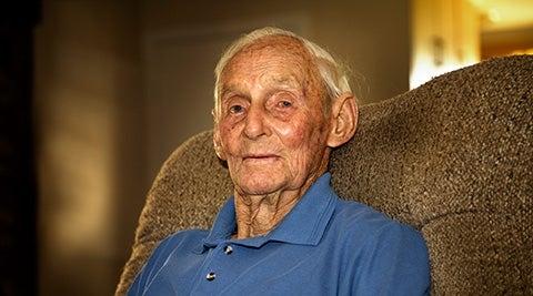 elderly Australian man in a chair