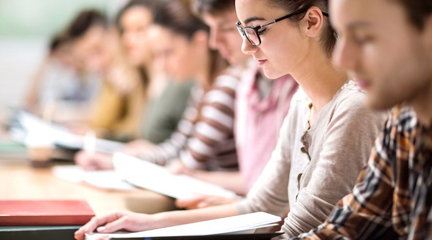 University students in lecture theatre (stock photo)