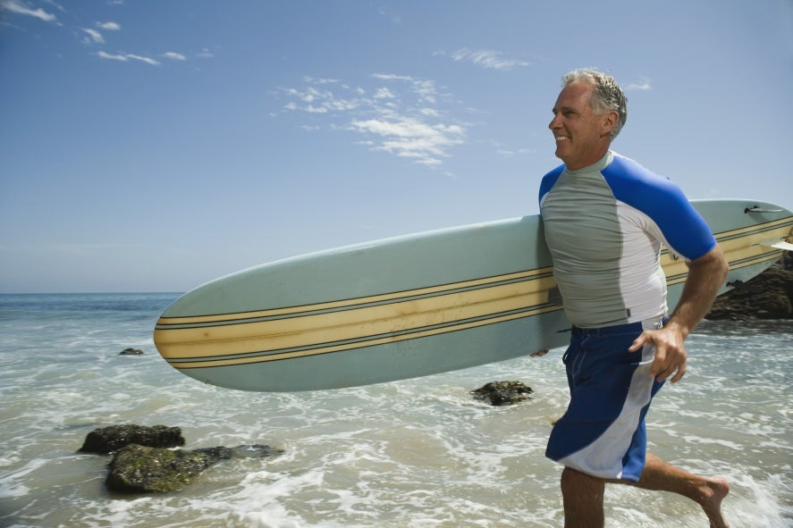 Man carrying surfboard