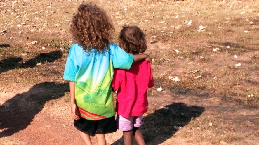 Two Aboriginal children walking
