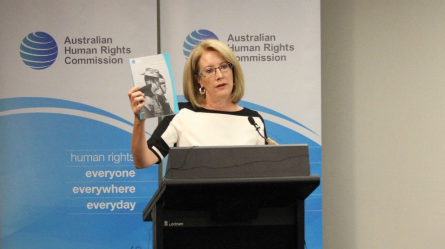 Elizabeth Broderick holds up the Audit Report at the launch