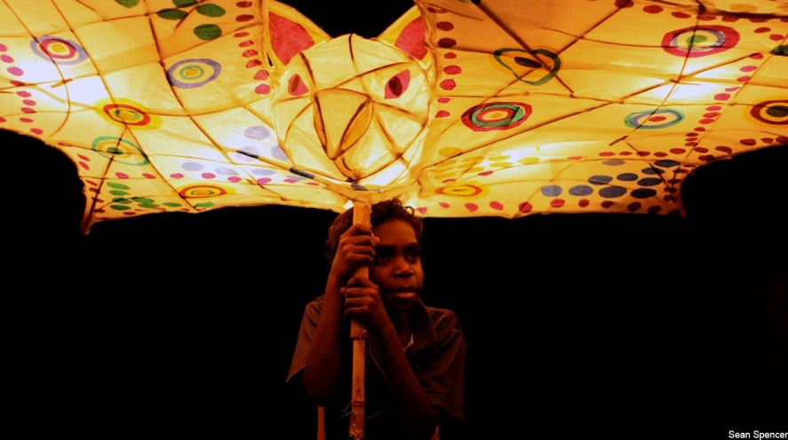 Photo of Aboriginal boy with bat lantern. Nimbois Bat by Sean Spencer.