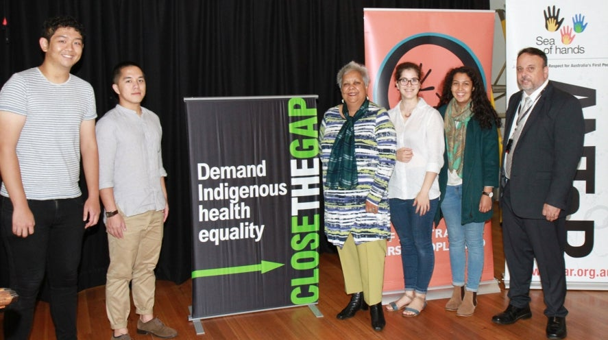 National Congress of Australia's First Peoples volunteers Kevin Lee (left) and Dickson Luo; Congress and Close the Gap Campaign co-chair Jackie Huggins; volunteers Isabel Hernandez and Cliantha Dawit-Dessay; and Congress CEO Gary Oliver