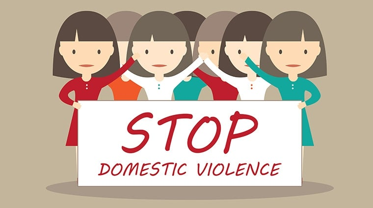 "cartoon of women of diverse backgrounds behind a sign reading ""Stop domestic violence"""