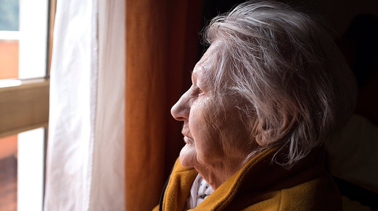 Older lady looking out of a window
