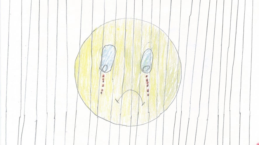 Children's drawing of sad face crying